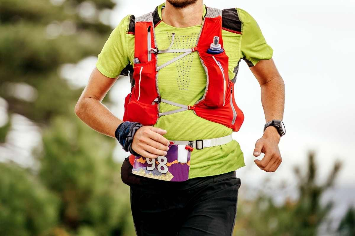 Runner with hydration vest on